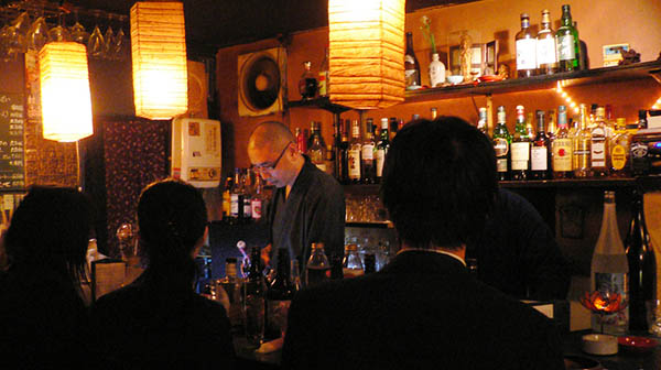 At Vow's Bar in Tokyo, Buddhist monks run the place and serve up advice along with cocktails. Here's a monk serving drinks on Monday.
